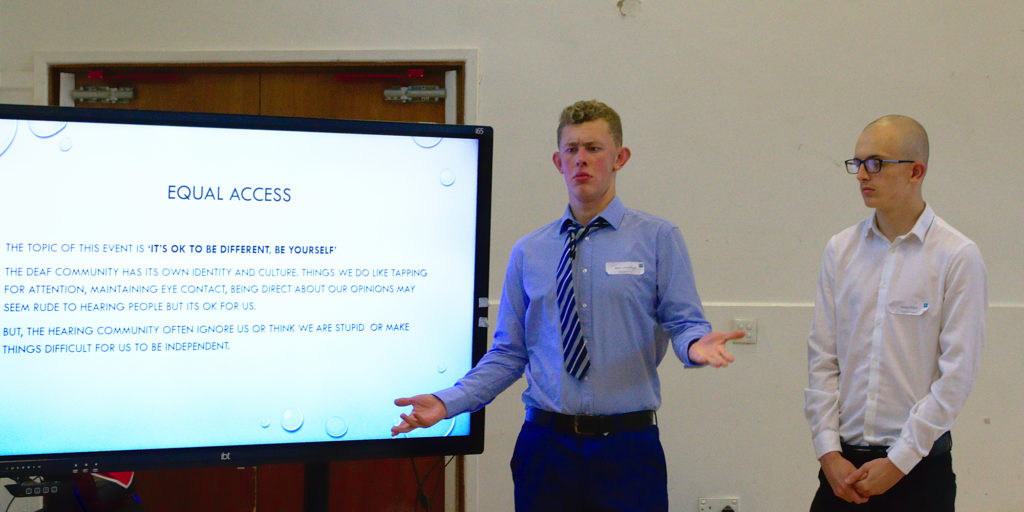 Two students giving a presentation at the student voice parliament